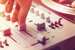 Dj playing and mixing music on turntable controller. At nightclub royalty free stock images