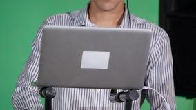 DJ playing music at mixer closeup stock video