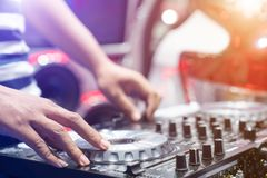 DJ playing music at mixer closeup Stock Image