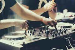DJ playing music at mixer closeup stock image