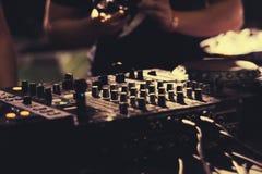 DJ playing music at mixer closeup royalty free stock photo