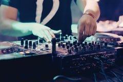 DJ playing music at mixer closeup stock photo