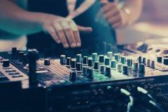 DJ playing music at mixer closeup royalty free stock photography