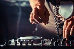DJ playing music at mixer, hands closeup Stock Photo