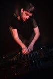 Dj playing music and mixing tracks Stock Photo