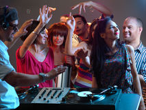 Dj playing music in night club Royalty Free Stock Photo