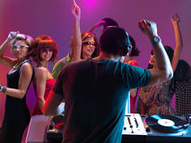 Dj playing music in night club Stock Image