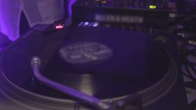 Dj playing music at night club. Vinyl record spinning on the turntable. Party. Stock footage stock video footage