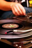 DJ playing music from turntable Royalty Free Stock Photography