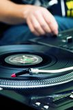 DJ playing music from turntable Stock Images