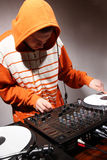 DJ playing music on vinyl turntables Stock Photo
