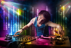 Dj playing songs in a disco with light show Stock Photography