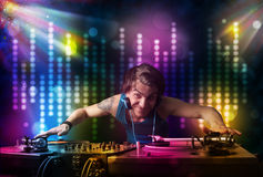 Dj playing songs in a disco with light show Stock Images