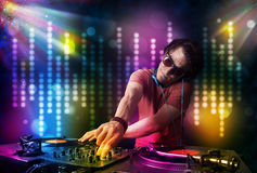 Dj playing songs in a disco with light show Stock Photos