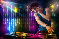 Dj playing songs in a disco with light show Royalty Free Stock Photo