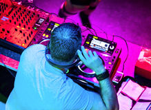 Dj playing the track. Dj in headphones mixes the track in the nightclub at party Stock Photo