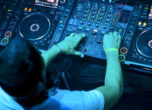 Dj playing the track. Dj mixes the track in the nightclub at party. Top view Stock Images