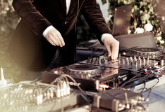 Dj playing the track in the nightclub Stock Image