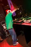 DJ playing turntable in the club. Hip-hop deejay rocking the crowd in the nightclub Stock Images