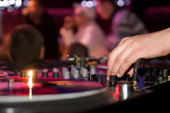 DJ playing vinyl. Dj's hand on a mixer Stock Images
