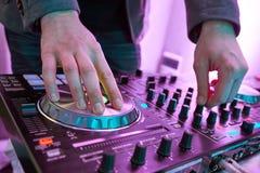 DJ plays and mix music on digital midi mixer controller. Stock Photo