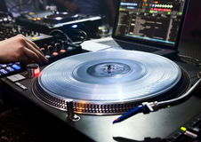 DJ plays set in vinyl player Royalty Free Stock Photo