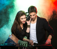 DJ. Portrait of two DJ's at the work, in the club. Light and fog on the background Royalty Free Stock Images