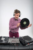 DJ posing with vinyl record Royalty Free Stock Image