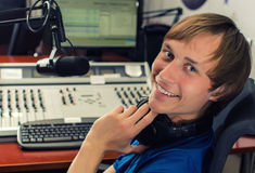 Dj on the radio. Dj in front of a microphone on the radio Royalty Free Stock Photography