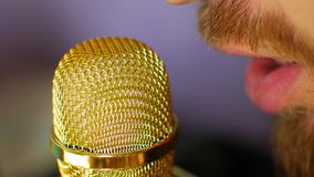 DJ on the radio speaks into the microphone. Man dictates voice acting in a recording studio