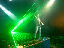 DJ in the rays of light Royalty Free Stock Photography