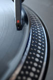 DJ Record Needle. DJ record player with a macro closeup of the stylus on a 12 inch vinyl LP playing hiphop techno rave beats royalty free stock photography