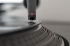 DJ Record Turntable. Macro closeup of the needle on a 12 inch vinyl LP playing hiphop techno rave beats royalty free stock image