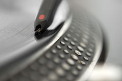 DJ Record Turntable. Macro closeup of the needle on a 12 inch vinyl LP playing hiphop techno rave beats stock photo