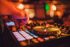 DJ remote, turntables, and hands . Night life at the club, party. stock photo
