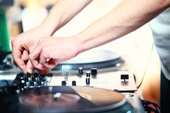 DJ's hand. Spinning vinyl record Royalty Free Stock Photo