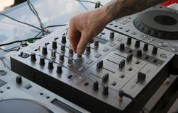 DJ`s hand on the music, control panel stock photo