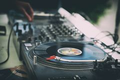 DJ`s hands and turntable. Closeup. selective focus Stock Images