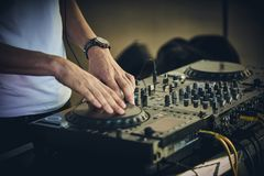 DJ`s hands and turntable. Closeup. selective focus Royalty Free Stock Photo