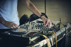 DJ`s hands and turntable. Closeup. selective focus Royalty Free Stock Photos