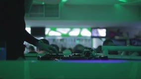 Dj's hands tweaking controls on sound board, party in nightclub. Stock footage stock footage