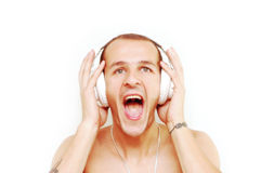 DJ's scream. Young DJ with tattoos on arms screaming while his music pushes him Stock Images