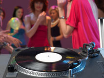 Dj's turntable closeup in a night club Stock Photos