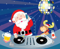 DJ Santa Claus. In action with his deer Stock Images