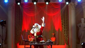 DJ Santa Claus mixing up some Christmas event.