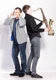 DJ and saxophonist in studio Royalty Free Stock Photo