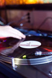Dj is scratching. A lp in a disco Stock Photos