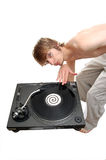 DJ scratching on a turntable. A white DJ scratching on a turntable Stock Photography