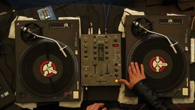 DJ scratching turntables performing show after party night club