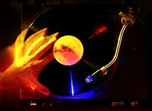DJ  scratching a vinyl disc. Hand of DJ  scratching a record, colorful lights Stock Photography